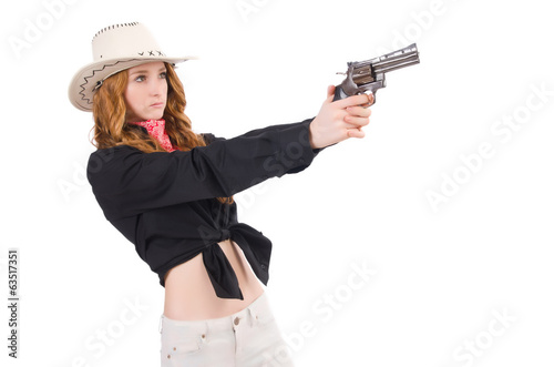 Young cowgirl with handgun isolated on white