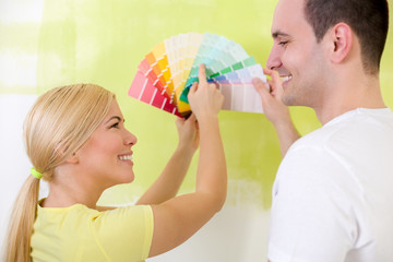Smiling couple with color samples