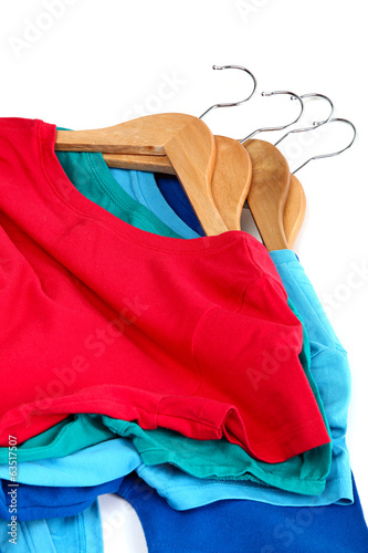Fashion clothing on hangers at the show on white background.