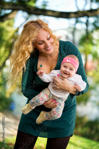 Young mom with baby in park