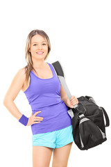 Female athlete carrying a sports bag