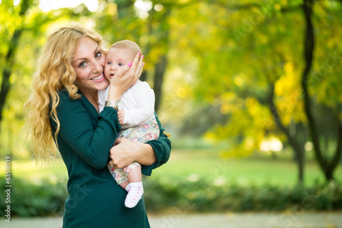 Portrait of young mother with baby