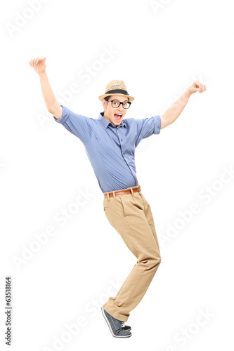 canvas print picture Full length portrait of an excited man dancing