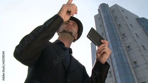 Businessman with GPS smartphone in the city