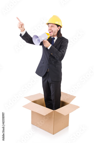 Man with hardhat and loudspeaker standing in the box