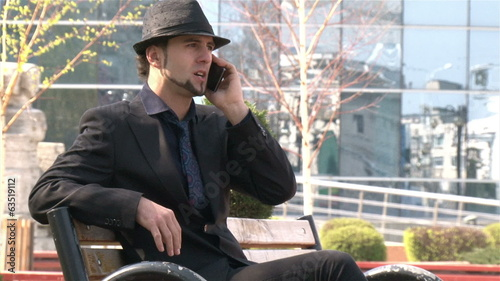 Businessman on the phone in a park