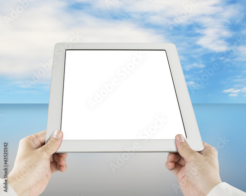 Holding tablet with sky reflection table