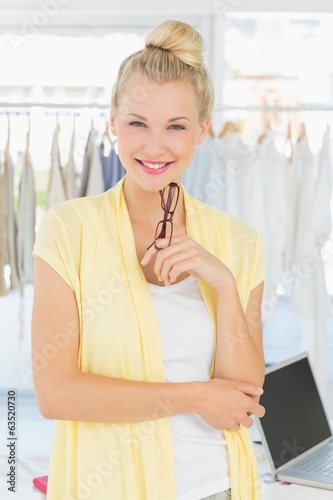 Portrait of a beautiful female fashion designer