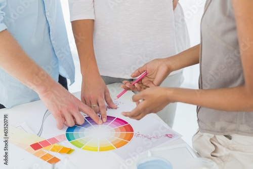 Interior designer showing colour wheel to customers