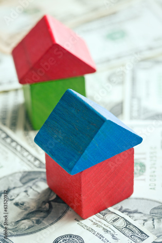 house made from wooden toy blocks on dollar background