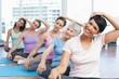 canvas print picture - Class stretching neck in row at yoga class
