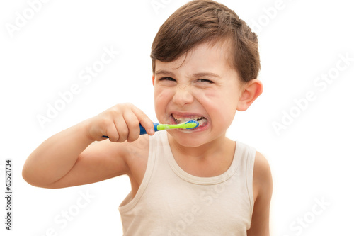 Boy brushing teeth isolated