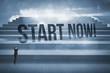 Start now! against steps against blue sky