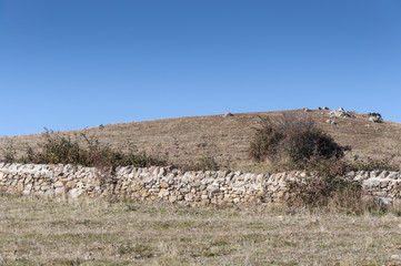 Old stone wall in Colmenar Viejo, Madrid, Spain