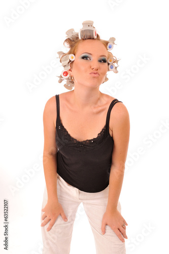 Woman with curlers giving a kiss.