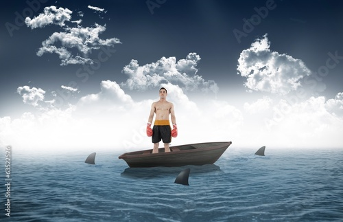 Composite image of boxer standing in a sailboat