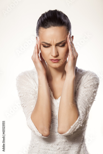 beautiful young woman with strong headache