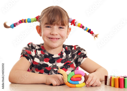 happy little girl with snail plasticine figure