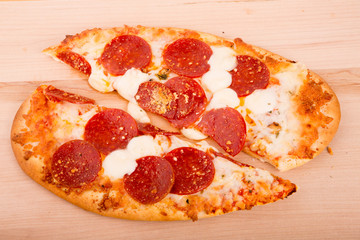 Oval Pepperoni Pizza Cut in Half