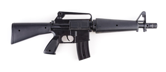 Black plastic gun isolated white background