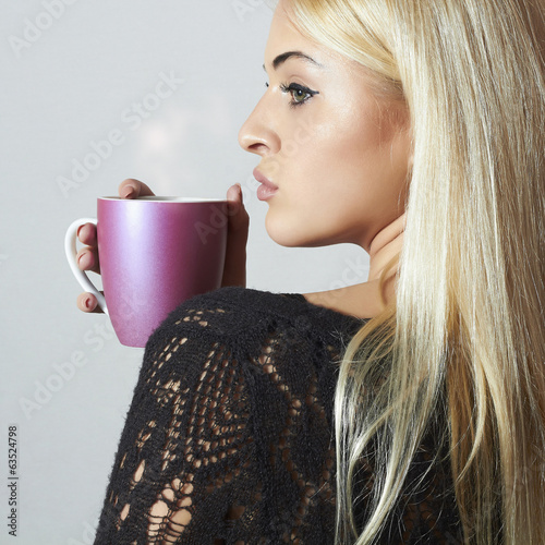 Beautiful blond woman drinking Coffee. Cup Hot drink