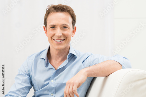 Happy Man On Sofa