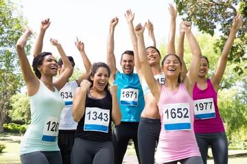 Friends cheering after winning a race