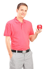 Casual young man holding an apple