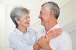 Affectionate retired couple smiling at each other