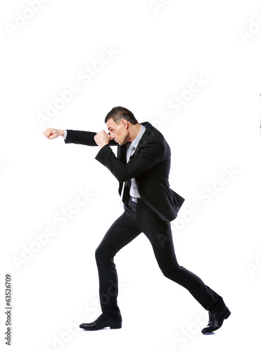 Side view portrait of a businessman punching