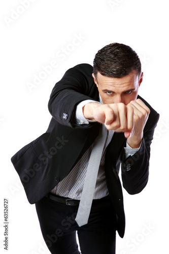 Businessman punching isolated on a white background
