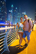Couple on holidays in Dubai city at night
