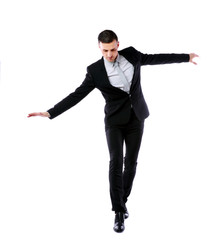 Businessman walking on invisible rope