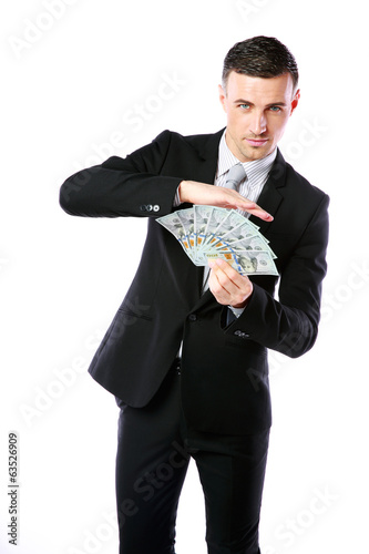 Handsome businessman holding US dollars