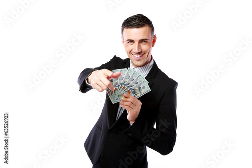 Rich businessman holding US dollars and showing on you