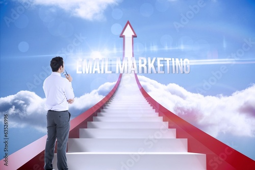 Email marketing against red steps arrow pointing up against sky