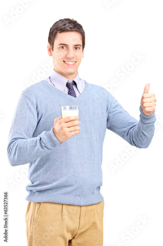 Man holding a glass of milk and giving thumb up