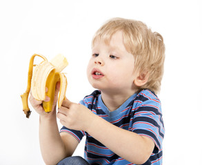 Сhild eats banana
