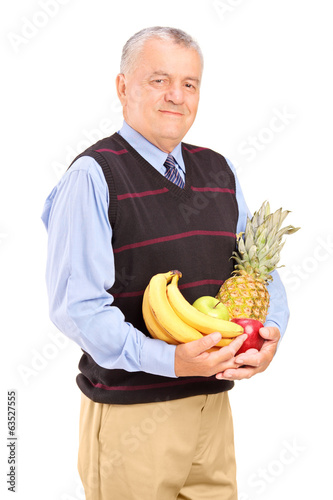 Mature man holding bunch of fruit in his hands