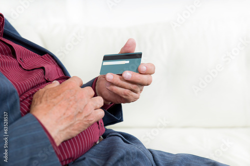 Senior hands with credit card,selective focus.