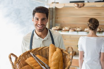 Waiter with basket of breads at the coffee shop