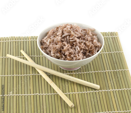 Cooked red rice in bowl and chopstick