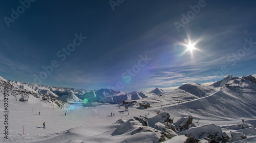 Swiss ski slope and ski lift station lens flare