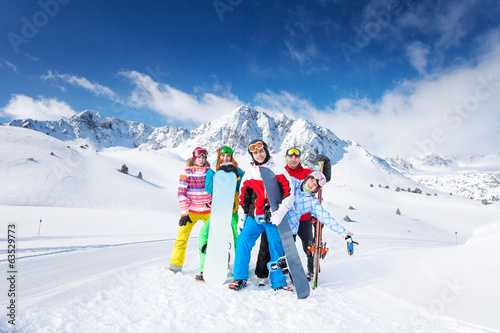 Positive group of 5 snowboarders