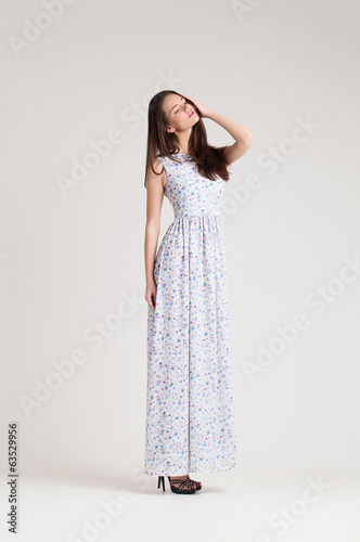 Girl in fashion dress. Spring collection