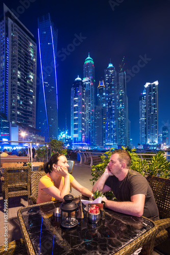 Couple on romantic dinner in Dubai marina at night