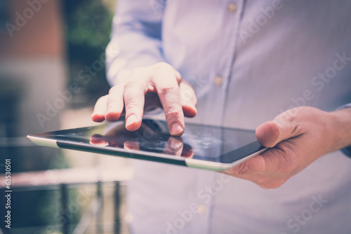 close up hands multitasking man using tablet