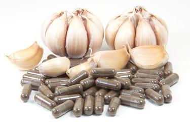 Garlic herbal capsules isolated on white background.