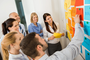 Businessman Explaining Labels On Whiteboard