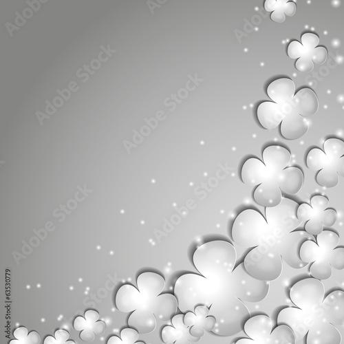 серые бумажные цветы на сером фоне